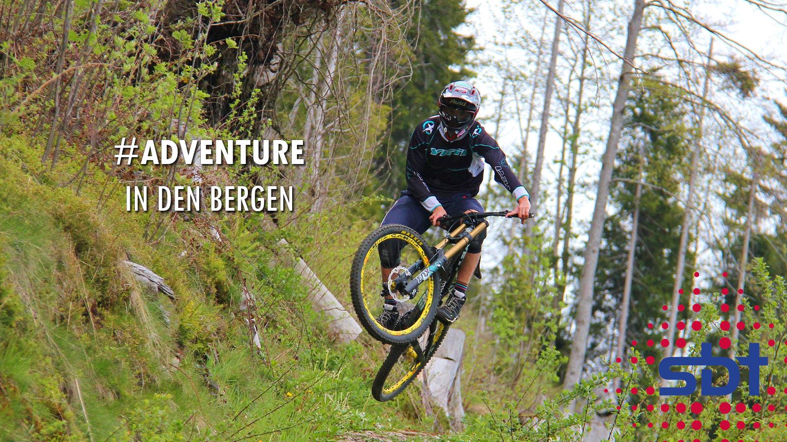 Berner Oberland - Adventure und Action - Downhillfahrer im Wald